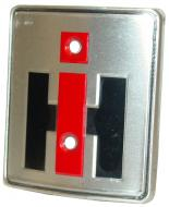 "HOOD EMBLEM  IH LOGO  RED & BLACK, 2-9/16"" W X 2-7/8"" H  International Applications: SUPER H, SUPER HV, SUPER M, SUPER MV, SUPER MTA, SUPER WD9, WDR9  Replacement Part #: IH: 357650R1"